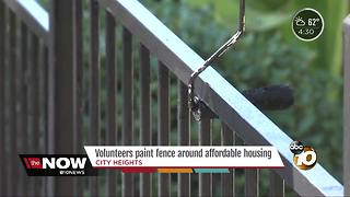 Volunteers help improve City Heights property - Video