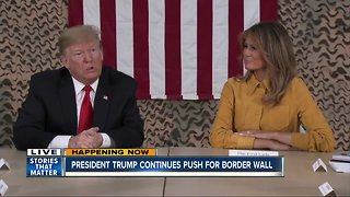 Trump touts border wall as shutdown enters sixth day