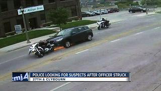 Police looking for suspects after officer injured in hit-and-run - Video