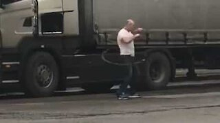 Truck driver does hula hoop as exercise routine