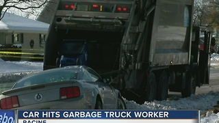 Racine garbage truck worker killed in crash - Video