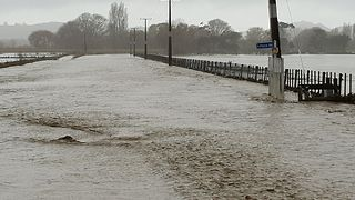 Road Becomes Flowing River in Tolaga Bay Floods - Video