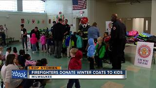 Firefighters donate winter coats to kids