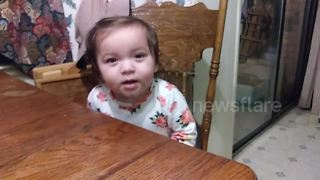 Hilarious moment when baby girl realizes dad is filming - Video