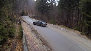 Professional driver drifts on tight mountain road - Video