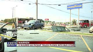 6 injured as pickup truck plows into bus stop - Video