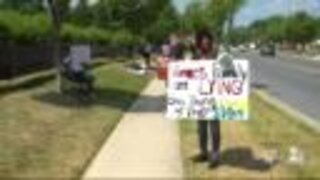 Protestors line up outside Vince's Crabhouse during owners' press conference