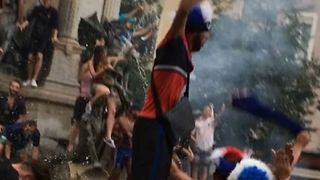 French Fans Celebrate World Cup Win With Fountains, Flags, and Fire