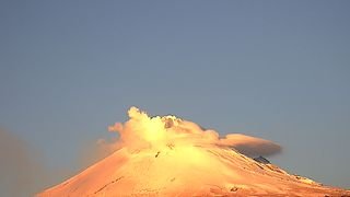 Mexico's Popocatepetl Volcano Spews Ash, Smoke while Covered in Snow - Video