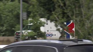 Ambulance carrying Southport police officer arrives at hospital following shooting - Video