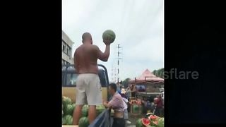 Chinese Vendor Catches Watermelons With One Hand - Video