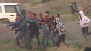 Protesters Carry Away Man After Reports of Deaths and Injuries in Gaza Protest - Video