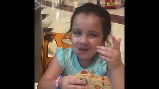 Sienna taste tests a giant cookie! Watch her reaction!  - Video