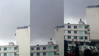 Indian teen falls from terrace of six-storey college building - Video