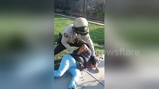 Police officer tackles flower vendor to the ground during arrest - Video
