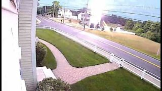 Security camera records moment lightning strike hits home