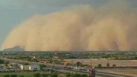 Steep Wall of Dust Sweeps Over Southern Arizona, Envelops Mountain