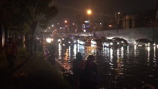 Cars stranded in flood water after tropical storm hits the Philippines - Video