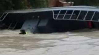 Police Pontoon Boat Capsizes in Fast-Moving Houston Floodwaters - Video
