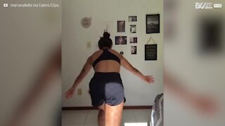 Gymnast nearly trashes decor doing handstand