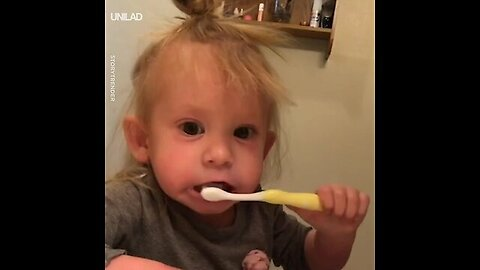 Kid Pretends Her Toothbrush Is Electric