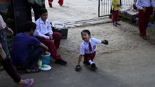 SPECIALLY-ABLED INDONESIAN BOY, 8, WALKS THREE KILOMETRES ON HIS HANDS TO REACH SCHOOL