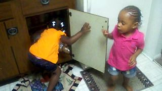 Toddlers have adorable kitchen cupboard fight