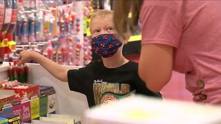 Wyoming boy who saved his sister from dog attack gets candy shopping spree in Denver