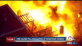 PHOTOS: Roof of condo complex catches fire near downtown Indianapolis