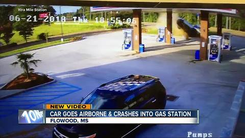 Car goes airborne, slams into gas station