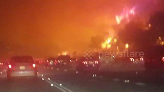 Night shots of Canyon fire raging near highway - Video