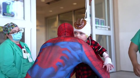 3-year-old burn victim gets visit from Spiderman as he is released from hospital