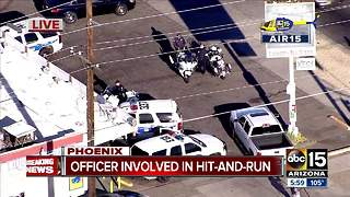 Suspect at large after hitting Phoenix motor officer - Video
