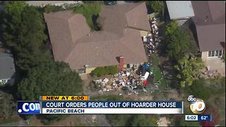 Court orders people out of hoarder house - Video