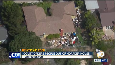Court orders people out of hoarder house