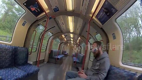 Man explores the Central Line carriage through the perspective of his drone