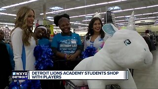 Detroit Lions Academy students shop with players