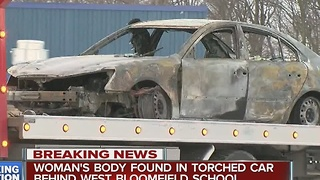 Woman's body found in burned out car