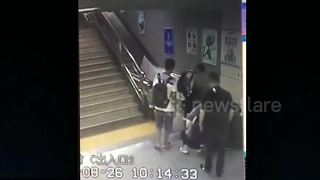 Terrifying moment woman falls through manhole in station