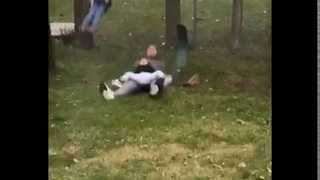 Father and Son Break Kids Swing in Playground - Video