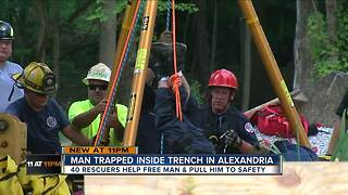 Man trapped inside trench in Alexandria - Video
