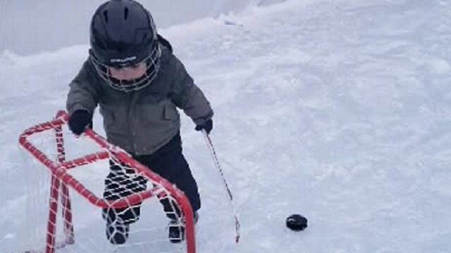 20-month-old hockey player finds clever way to score goal