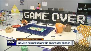 Metro Detroit domino builders work to set new record - Video