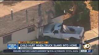 Child injured after truck crashes into Escondido home - Video
