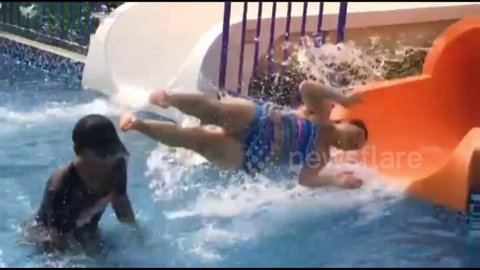 Tourist smashes into lifeguard as she exits water slide