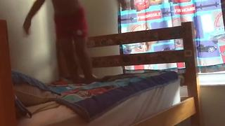 Happy Kid Jumps On Bed