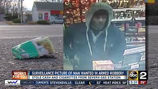 Surveillance picture of man wanted in armed robbery - Video