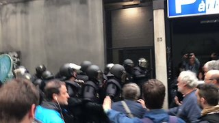 Man Has Convulsions After Being Dragged by Riot Police - Video