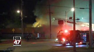 Crews battling fire at local party store