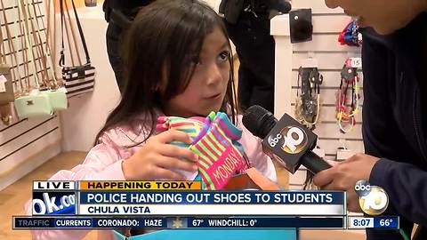 Police handing out shoes to students